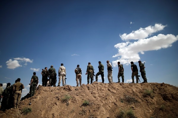 Kurdish Peshmerga fighters line up at a defensive point near Sinjar, Iraq, on June 1. (Alkis Konstantinidis/Reuters)