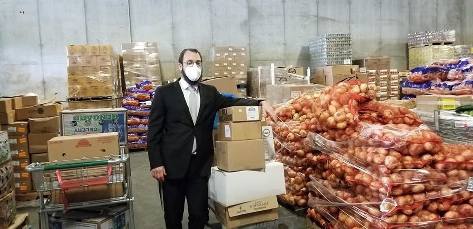 Rabbi Nochem Tenenboim with the food donated by a Hewlett Harbor resident that was distributed to people in need in the Five Towns and Queens.