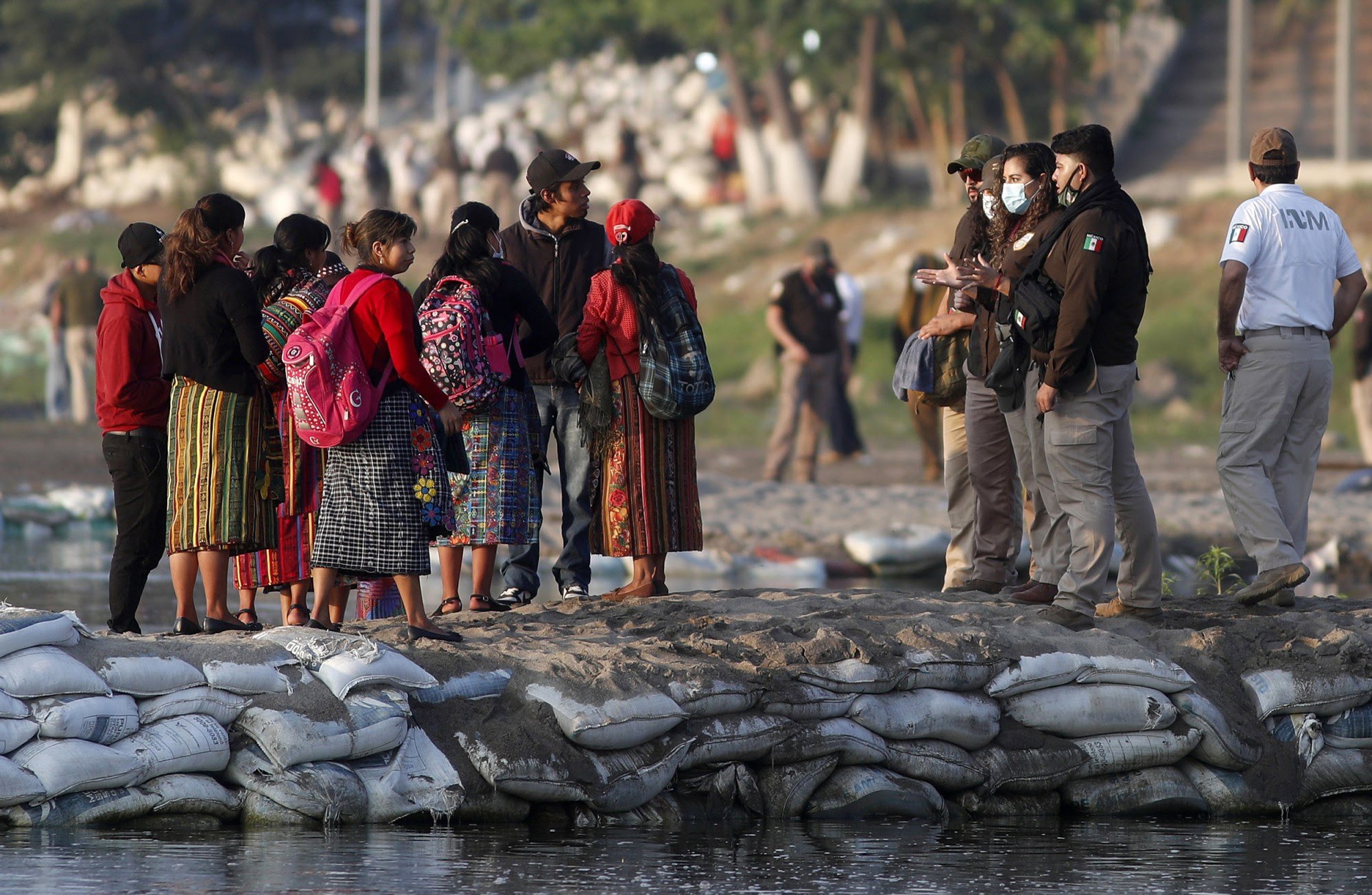 Mexican officials confronting immigrants at the US-Mexico border