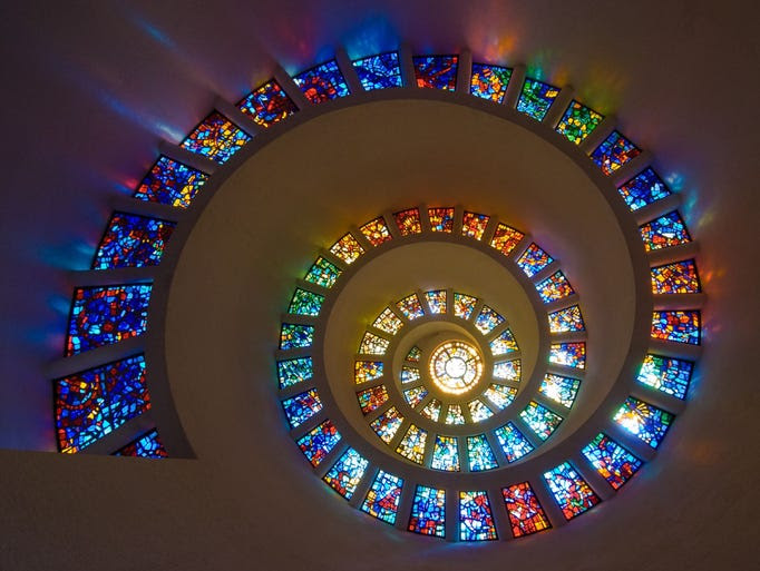 The                                                           spiral tower                                                           Chapel of                                                           Thanksgiving                                                           in Dallas                                                           isn't all that                                                           striking from                                                           the outside,                                                           but walk in,                                                           and you'll see                                                             the spiral                                                           Glory Window,                                                           one of the                                                           largest                                                           horizontally-installed                                                           works of                                                           stained glass                                                           in the world.