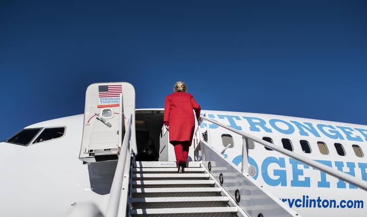 On the last day of campaigning, Hillary Clinton boards her plane. (Melina Mara/The Washington Post)