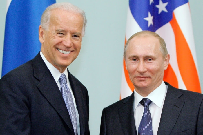 In this March 10, 2011 photo, then-Vice President Joe Biden, left, shakes hands with Russian Prime Minister Vladimir Putin in Moscow.