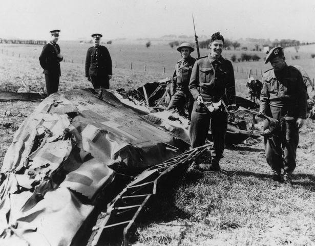 Soldiers and policemen in Eaglesham inspect the wreckage of the Messerschmitt ME-110 in which Nazi leader Rudolf Hess made his solo flight to Scotland
