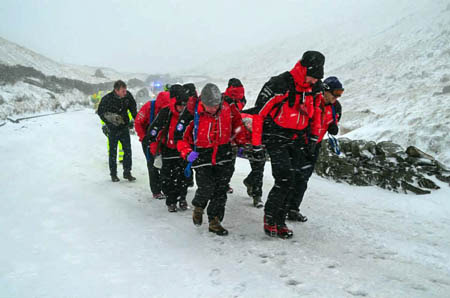 Rescuers stretcher one of the injured people from the scene. Photo: Langdale Ambleside MRT