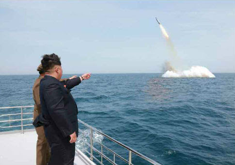 Kim Jong Un observes missile launch / KCNA