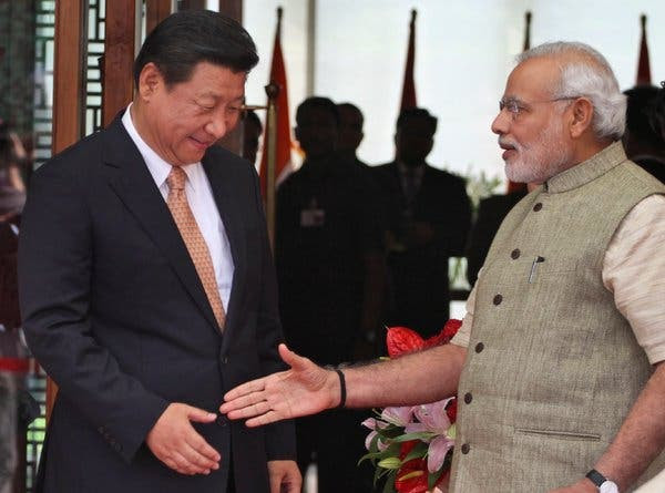 Prime Minister Narendra Modi of India, right, welcoming President Xi Jinping of China upon his arrival in Ahmadabad, India, last year.