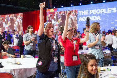 "Lauren Fowkes and Ashley Roti cheered during a speech by Nina Turner, a former Ohio state senator, at The People's Summit in Chicago on Saturday. Ms. Turner, who supports Senator Bernie Sanders, urged people not to allow the Democratic Party to return to ""business as usual."""