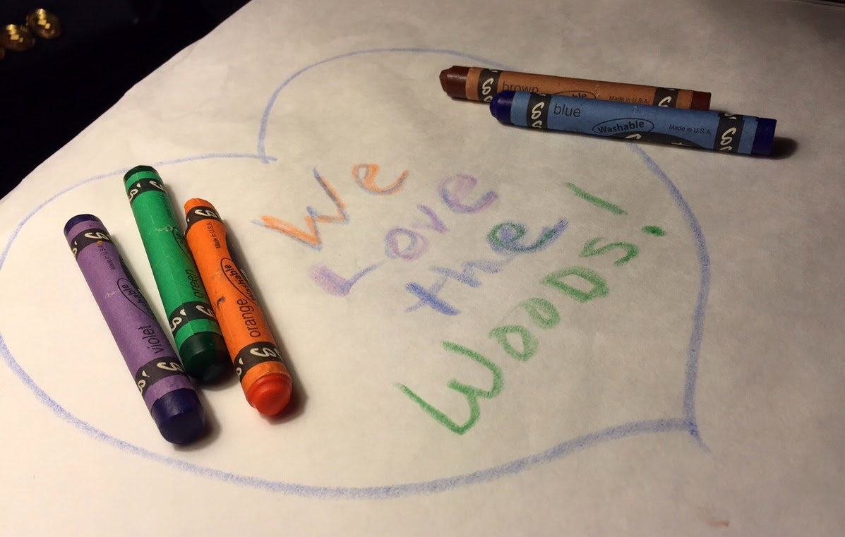 As we were preparing to leave, I picked up a few crayons (left on the table so children can entertain themselves drawing on the paper tablecloths) and left a message of our own.