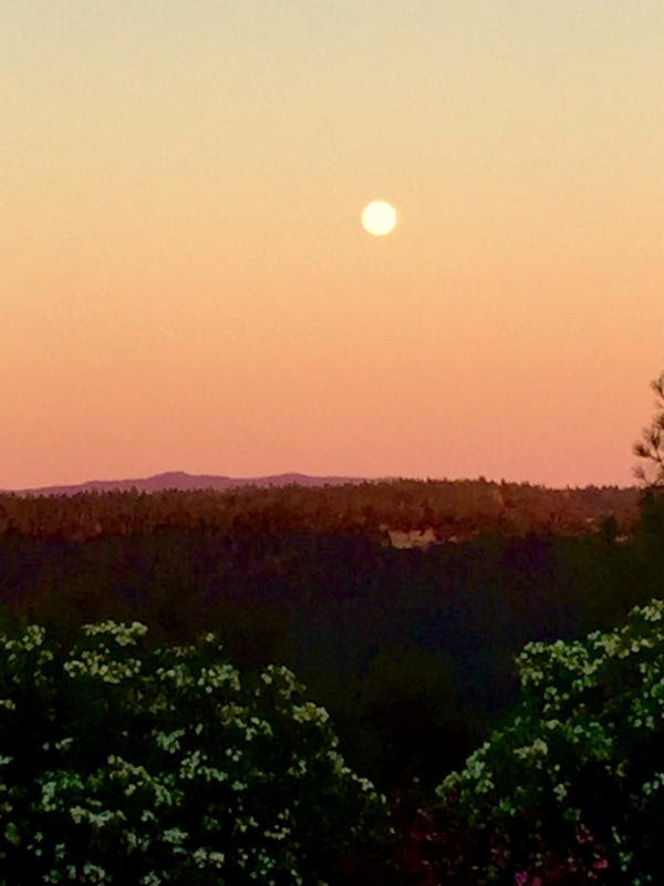 moon rise at sunset over Volcano
