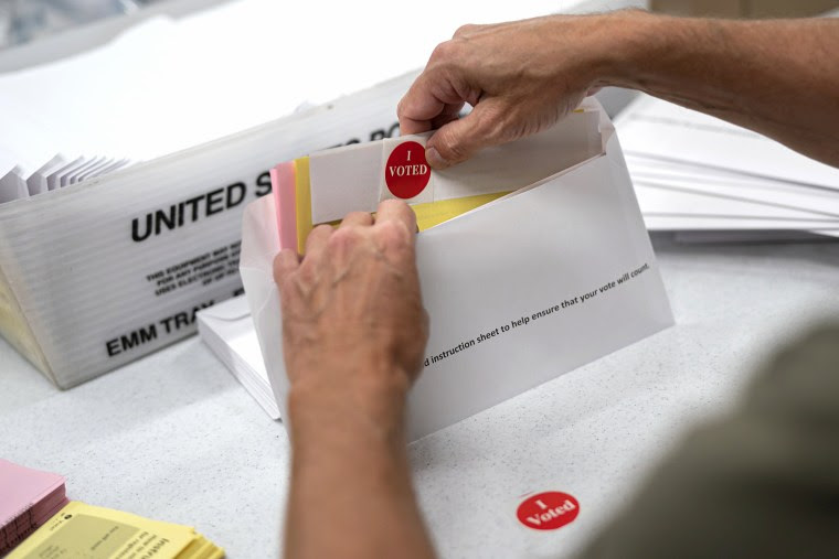 Mail sorting with an I voted sticker