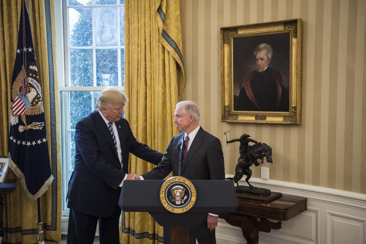 Trump welcomes Jeff Sessions to his swearing-in ceremony in the Oval Office. (Jabin Botsford/The Washington Post)