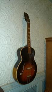 S.S. Stewart Arch Top Guitar - Sold for $510 at the MaxSold Turk's Antique Store Clearout Online Auction