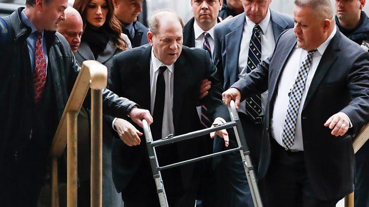 Weinstein using a walker