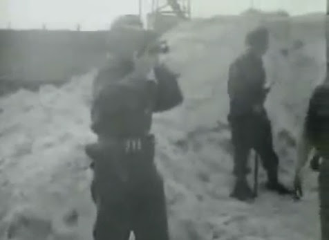 A                             cameraman filming SS men how they take dead                             bodies to the pit (15min. 12sec.)