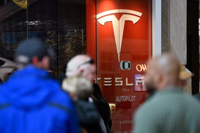 Tesla posts record loss as Model 3 production taps the brakes