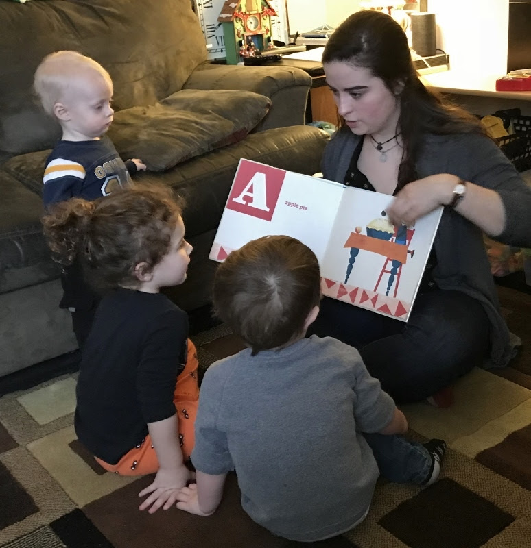 Becca Reading to Children