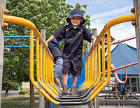 A young boy playing on a school playground