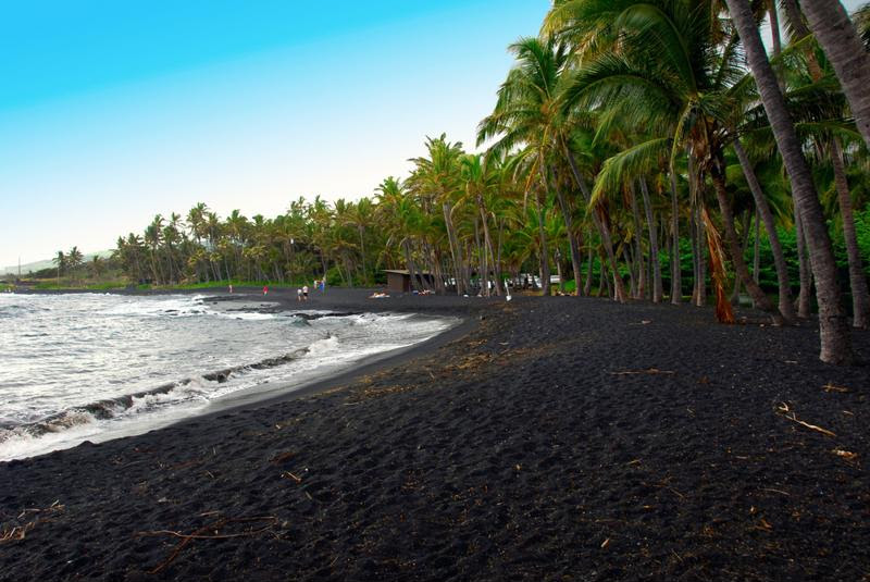 Volcanic activity makes the sand as black as coal.