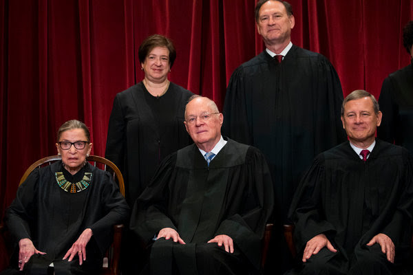 Justice Anthony Kennedy, center, has been a crucial vote on the Supreme Court for decades. He announced his retirement on Wednesday.