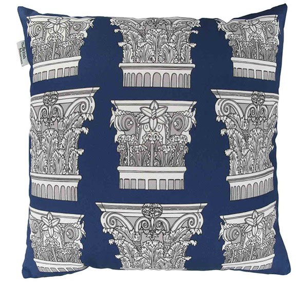 A blue cushion decorated with Roman architectural features.