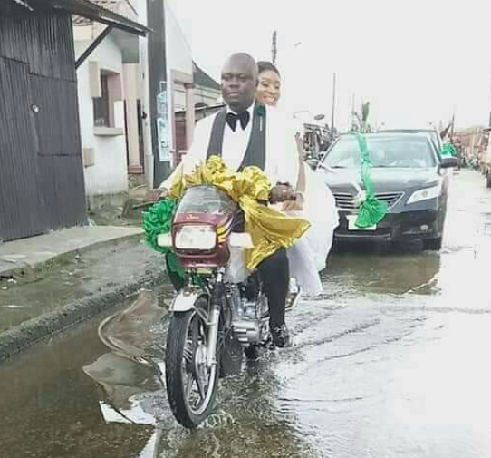 Nigerian couple ride home on a bike after their wedding in Rivers State (Photos)