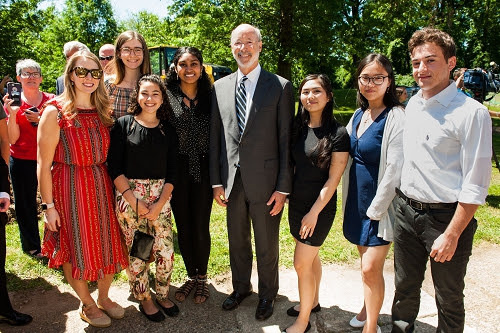 Ms. Ashley Zesserman, Governor Tom Wolf, and 278th class recent graduates