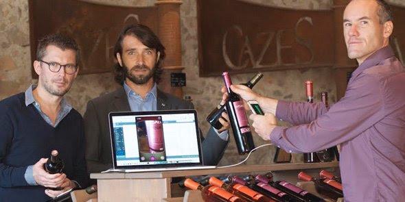 Dominique Laporte (au centre), avec les deux créateurs de WineAdvisor