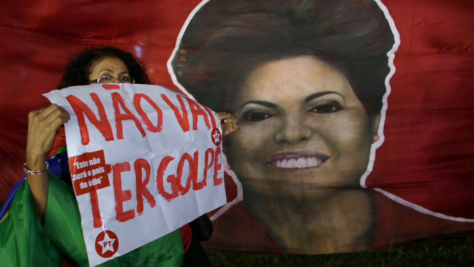 Woman shows poster written in Portuguese