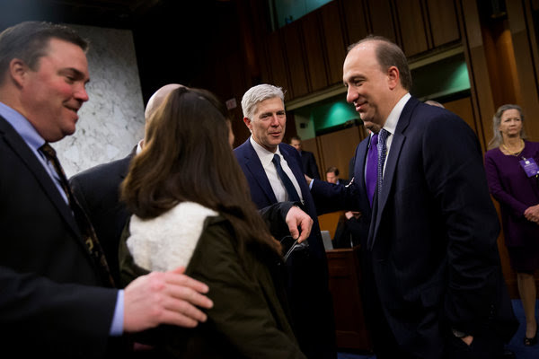 Judge Neil M. Gorsuch, center, at his Supreme Court confirmation hearing before the Senate Judiciary Committee in Washington on Wednesday.
