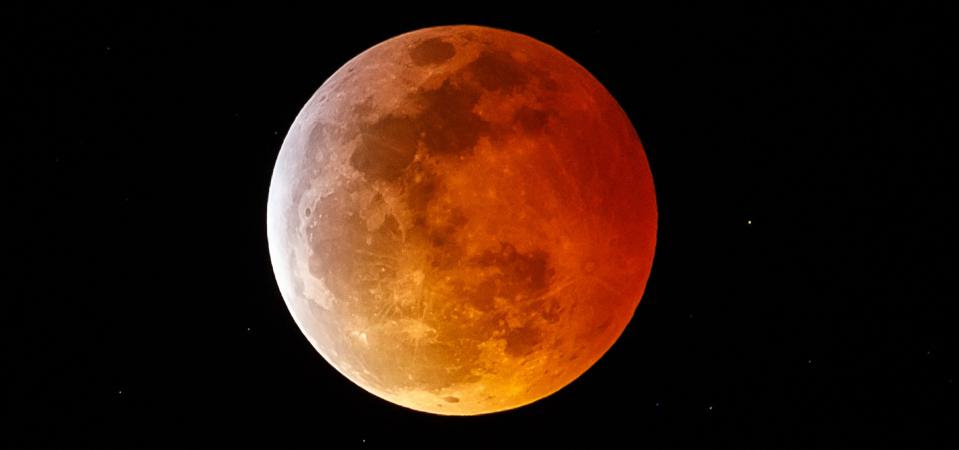 A photo of the moon displaying a red color during an eclipse.