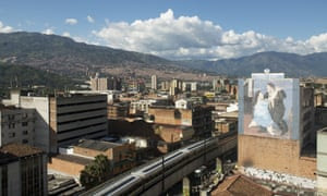 Fernando Botero's outsized figures adorn a wall in Medellín, with the Andes in the background.