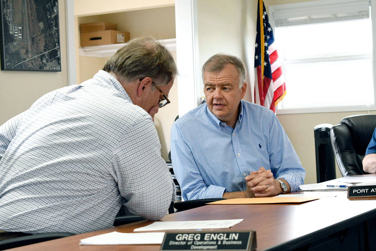 The Port of Port Townsend commissioners named planning director and in-house counsel Eric Toews, right, as interim executive director. Toews is shown talking with Greg Englin, director of operations and port development. (Jeannie McMacken/Peninsula Daily News)