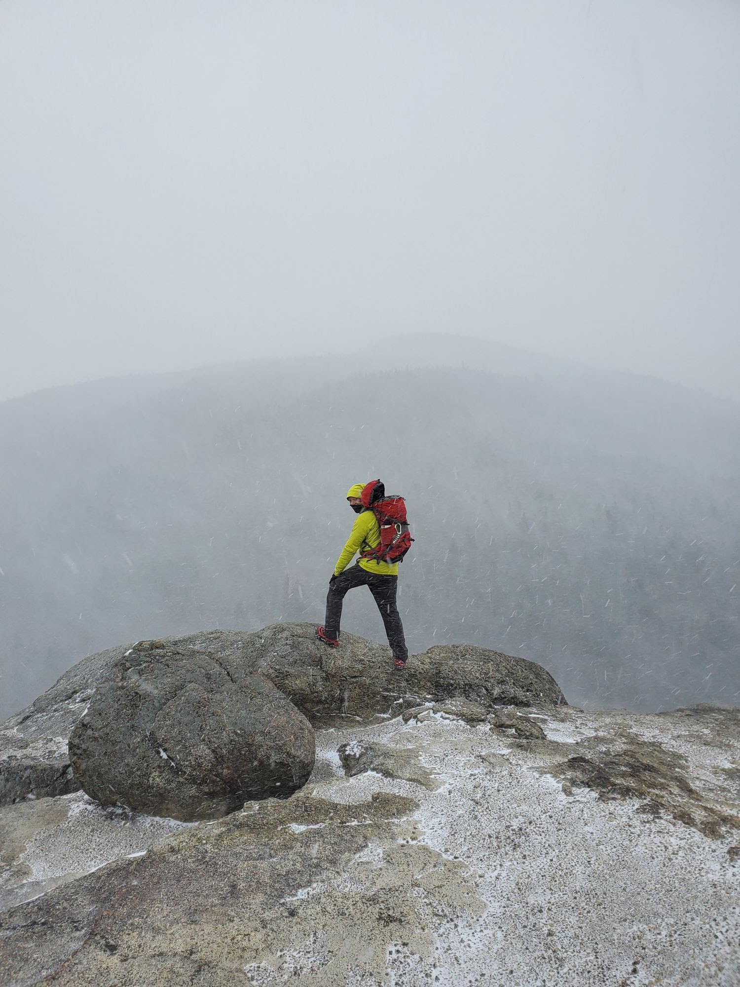 Hiker on summit in winter conditions