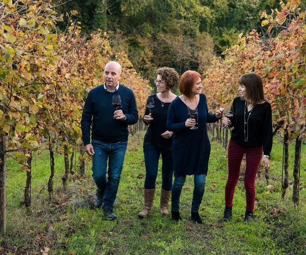 The Barbanera family - producers of Toscana Rosso da Uve Leggermente Appassite - walking through their vineyard.