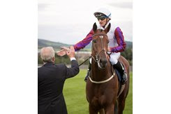 Danny Tudhope greets trainer Karl Burke after winning the Matron Stakes at Leopardstown