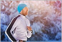 A man jogging during winter.