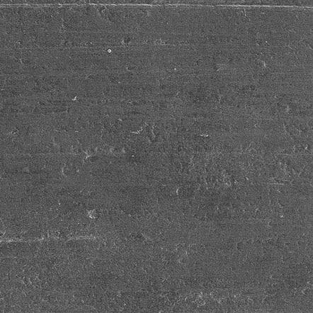 L'aluminium nu avant la gravure laser, vu au microscope électronique.  La surface est plutôt lisse.