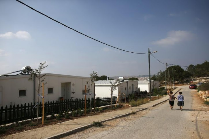 "Israeli women walk in a Jewish settlement known as ""Gevaot"", in the Etzion settlement bloc, near Bethlehem August 31, 2014. REUTERS/Ronen"