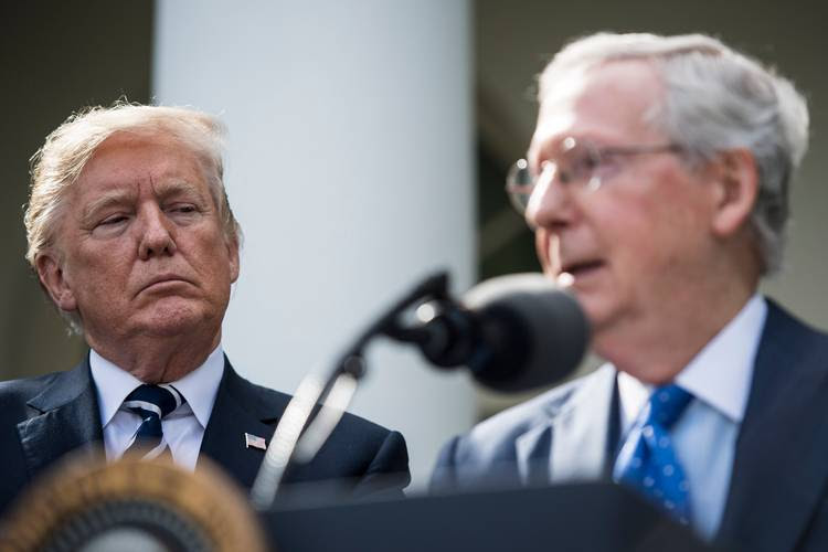 President Trump listens as Senate Majority Leader Mitch McConnell (R-Ky.) speaks in the Rose Garden. (Jabin Botsford/The Washington Post)