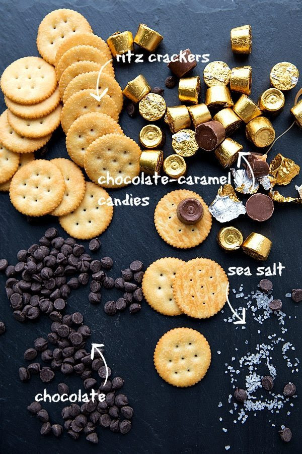 Ritz crackers with chocolate chips, chocolate caramel candies, and sea salt