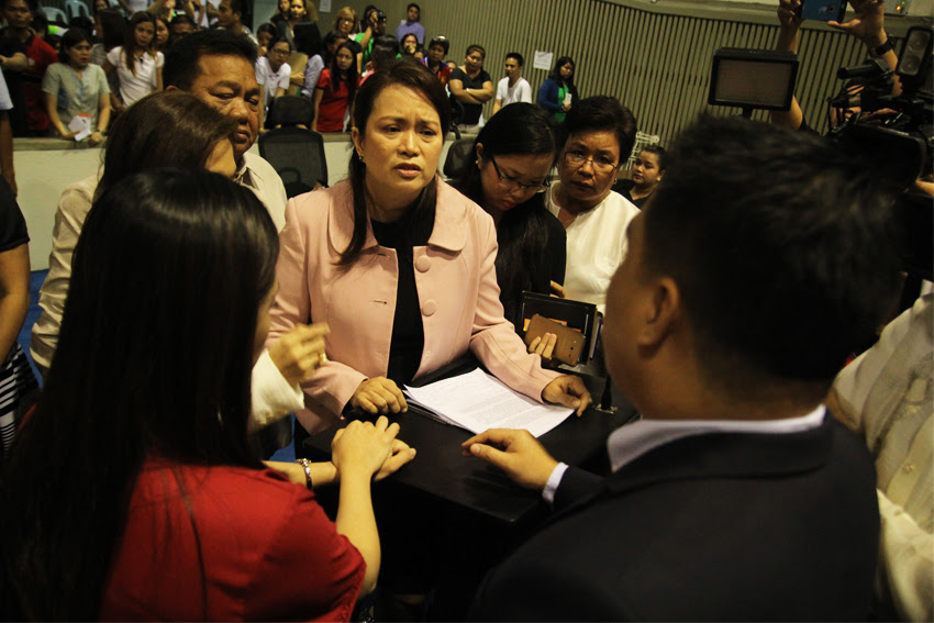 HOUSE TENSION. Davao City Councilor Mabel Sunga-Acosta turns emotional after being questioned by majority floor leader Councilor Bernard Al-ag for inviting Ateneo president Fr. Tabora to speak in the session regarding the 10% green space requirement for development projects in the city. (Ace R. Morandante/davaotoday.com)
