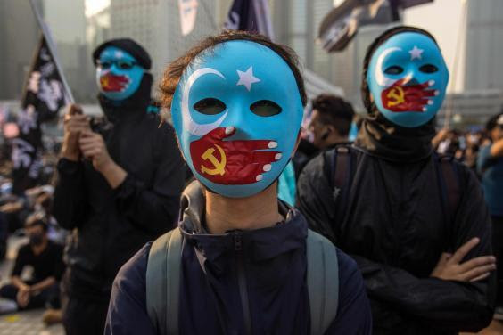 Protesters attend a rally in Hong Kong to show support for the Uighur minority in China (AFP/Getty)