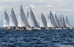 J/80s sailing off start at Kiel Week