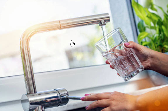 Woman filling a glass of water. Photo Courtesy of Getty Images.
