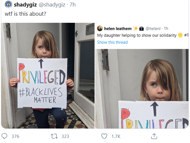 Tweet showing little girl holding a sign