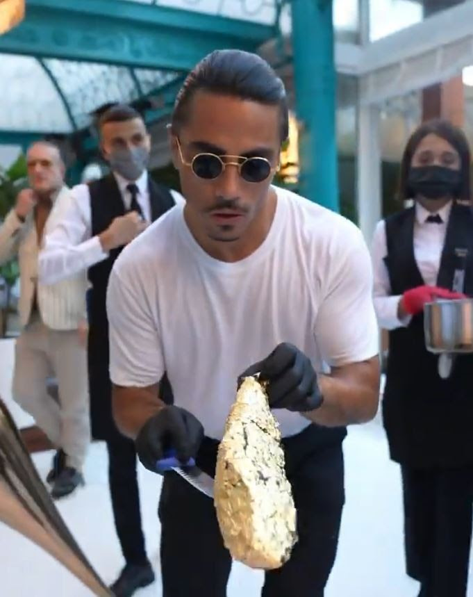 A chef who went viral when a meme showing him flamboyantly sprinkling salt was shared by millions of people has opened a restaurant in London