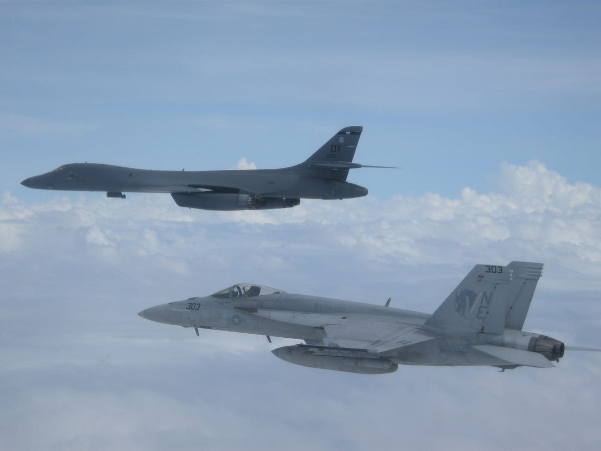 The strike group has plenty of aircraft along with them, like this A F/A-18E Super Hornet and a nuclear-capable B-1B Lancer from Guam.