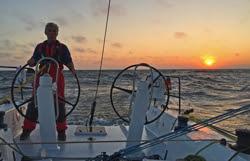 J/121 sailing at sunset