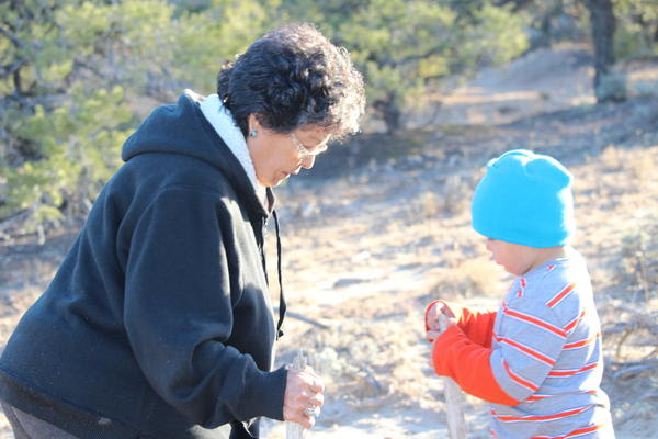 Sarah Jane White, with her grandson, worries that someday, children won't be able to find clean water on the Navajo reservation.