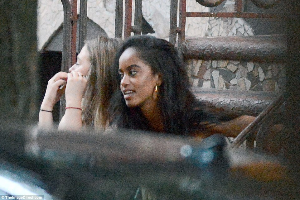 Malia relaxed on a stoop in the East Village with a friend before they decided to go for dinner